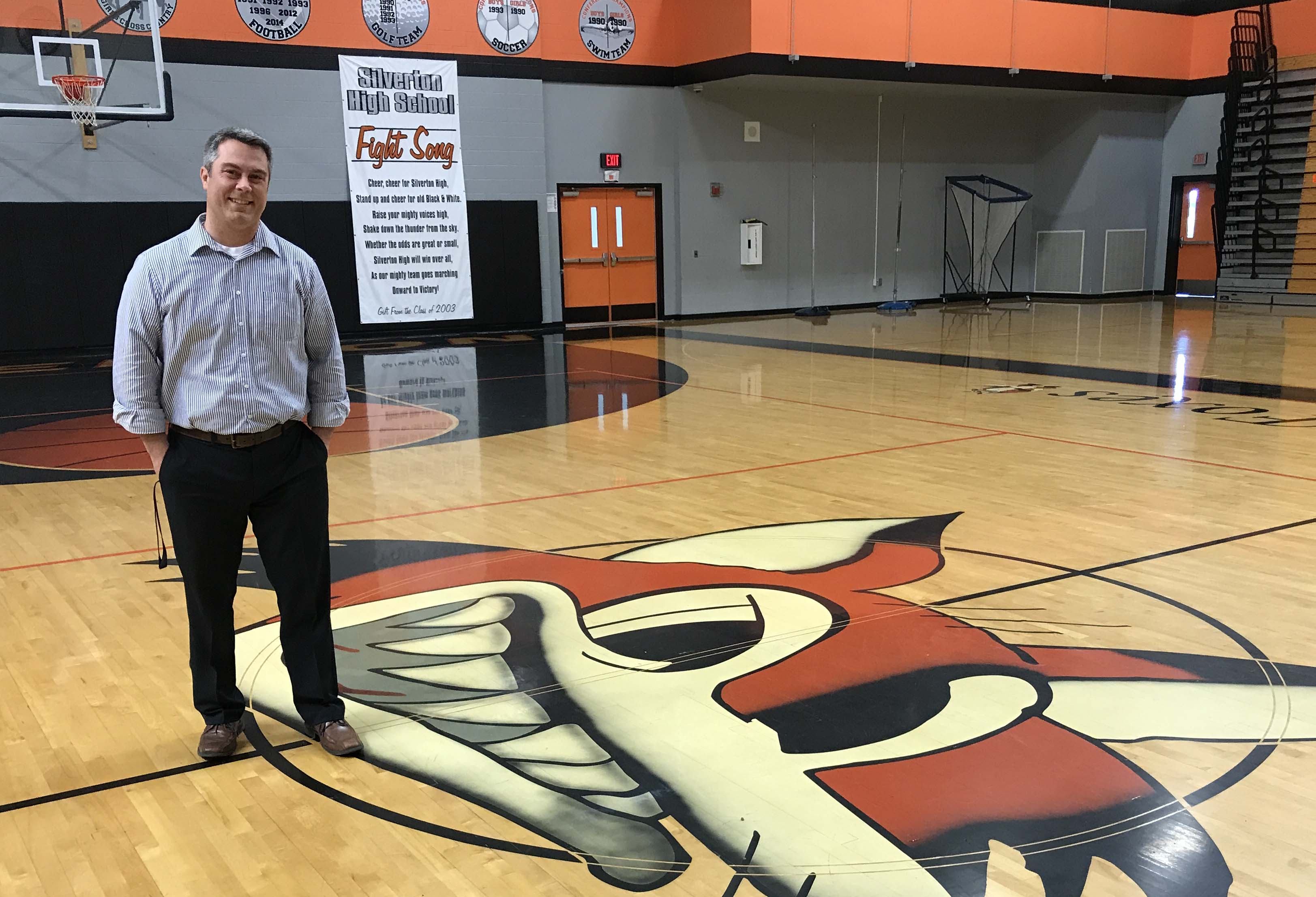 Wade Lockett stands near the fox at center court in the main SHS gym