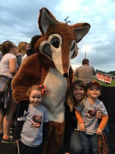 Johnie Ferro and her two children pose with the SHS Fox